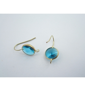 1 paio di monachelle dorate con cristallo tondo color azzurro misure 26 x 12 mm