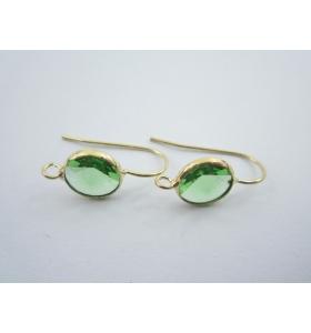 1 paio di monachelle dorate con cristallo tondo color verde misure 20 x 10 mm