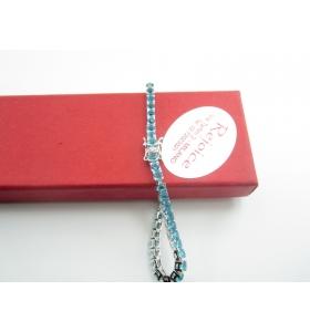 INGROSSO bracciale tennis in argento rodiato con zirconi topazio azzurro
