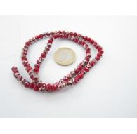 1 filo di cristallo sfaccettato stondato rosso con parti iridescenti 6x5 mm.