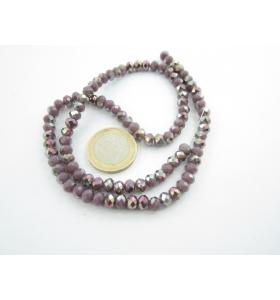 1 filo di cristallo sfaccettato stondato viola con parti iridescenti 6x5 mm.