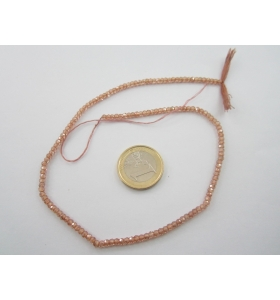 1 filo zirconi colore beige sfaccettati di 3 x 2,5 mm lungo 33 cm