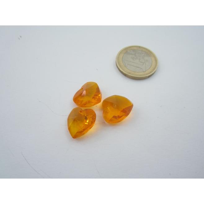 3 cuori in cristallo color ambra con foro