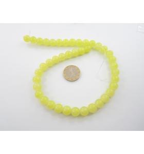 1 filo di perle di vetro color giallo  diametro 10 mm.