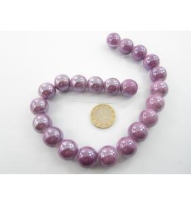 1 filo di perle di ceramica color lilla metallizzato  diametro 16 mm.