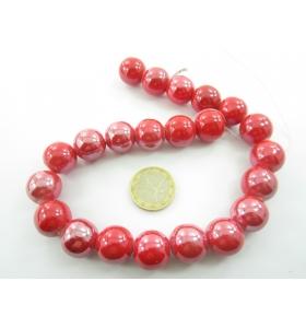 1 filo di perle di ceramica color rosso metallizzato  diametro 16 mm.