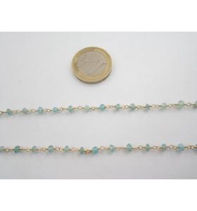 50 cm. di catena rosario tono dorato e cristalli color acquamarina 3,5 mm.