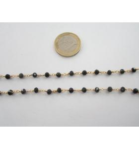 50 cm. di catena rosario tono dorato e cristalli color nero 4,5 mm.