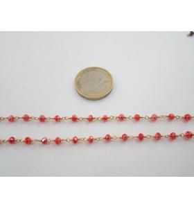 20 cm. di catena rosario tono dorato e cristalli color  rosso chiaro trasparente 3,5 mm.