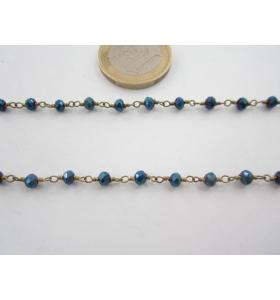 50 cm. di catena rosario tono dorato e cristalli color blu metallizzato 3,5 mm.