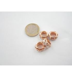 1 rondellina/distanziatore in rame dorato con strass  13x8,5 mm.