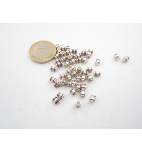 10 componenti in argentone ( argento tibetano ) piccoli cilindri 5x3,5  mm.