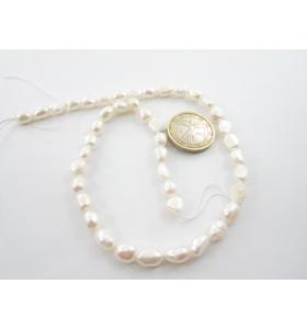1 filo di perle bianche a...